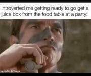 Introvert getting food from the table at a party